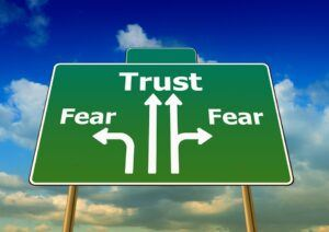 Trust instead of fear - road sign