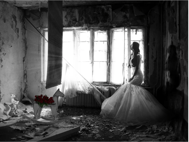 sad woman in a wedding dress, in a destroyed room looking out the window