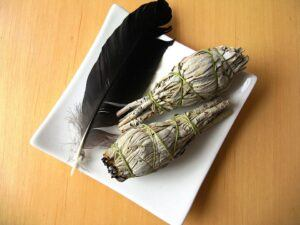 sage stick, feather, smudging, clearing your house